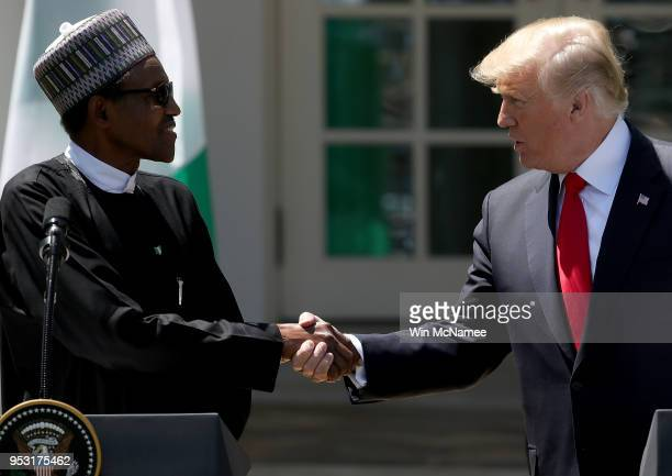 S President Donald Trump and Nigerian President Muhammadu Buhari shake hands during a joint press conference in the Rose Garden of the White House...