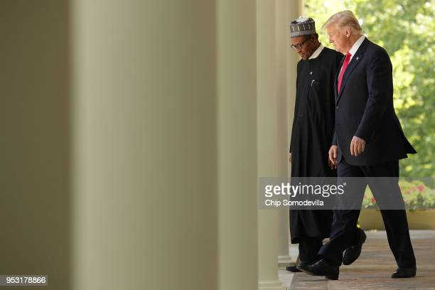 S President Donald Trump and Nigerian President Muhammadu Buhari walk into the Rose Garden for a joint press conference at the White House April 30...