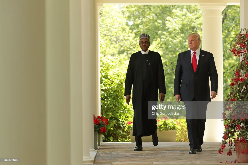 U.S. President Donald Trump (R) and Nigerian President Muhammadu Buhari walk into the Rose Garden for a joint press conference at the White House April 30, 2018 in Washington, DC. The two leaders also met in the Oval Office to discuss a range of bilateral issues earlier in the day.