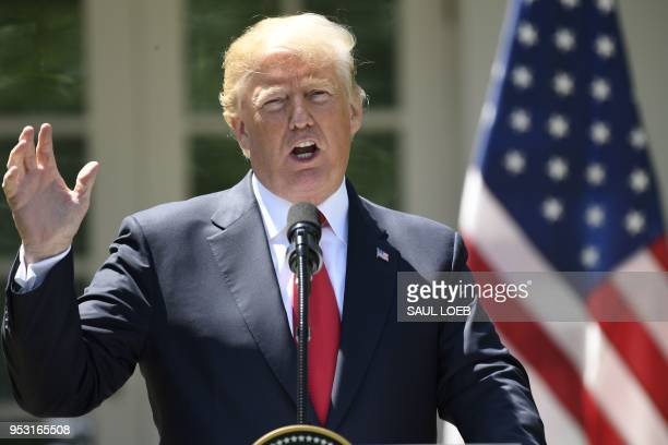 US President Donald Trump and Nigeria's President Muhammadu Buhari hold a press conference in the Rose Garden of the White House in Washington DC...