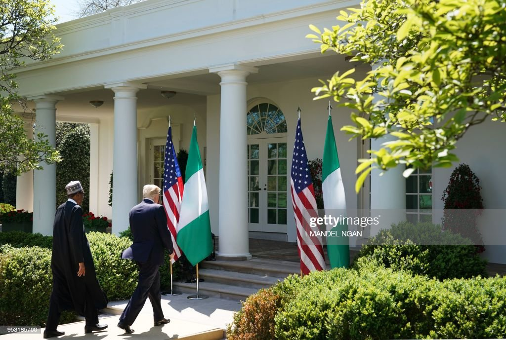 US President Donald Trump and Nigeria's President Muhammadu Buhari make their way from a joint press conference in the Rose Garden of the White House on April 30, 2018 in Washington, DC.