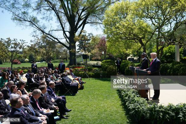 US President Donald Trump and Nigeria's President Muhammadu Buhari shake hands as they hold a press conference in the Rose Garden of the White House...
