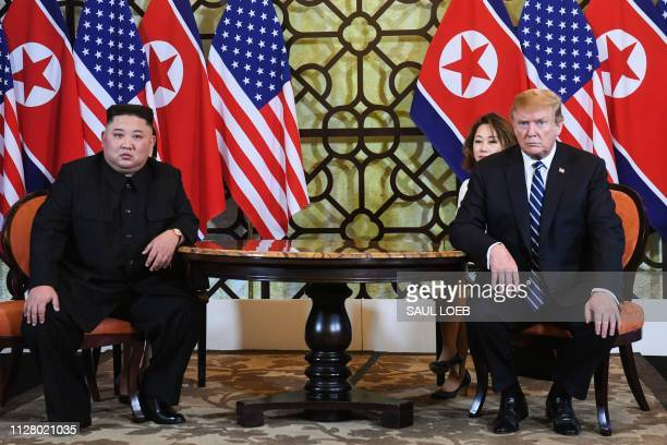 US President Donald Trump and North Korea's leader Kim Jong Un hold a meeting during the second USNorth Korea summit at the Sofitel Legend Metropole...