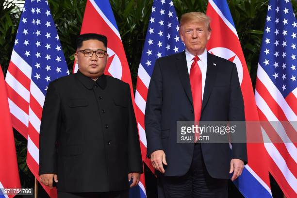 US President Donald Trump and North Korea's leader Kim Jong Un pose together at the start of their historic USNorth Korea summit at the Capella Hotel...