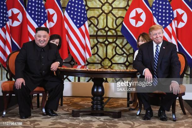 US President Donald Trump and North Korea's leader Kim Jong Un smile during a meeting at the second USNorth Korea summit at the Sofitel Legend...