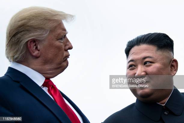 President Donald Trump and North Korea's leader Kim Jongun talk before a meeting in the Demilitarized Zone on June 30 in Panmunjom Korea