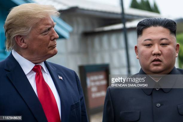 US President Donald Trump and North Korea's leader Kim Jongun talk before a meeting in the Demilitarized Zone on June 30 in Panmunjom Korea