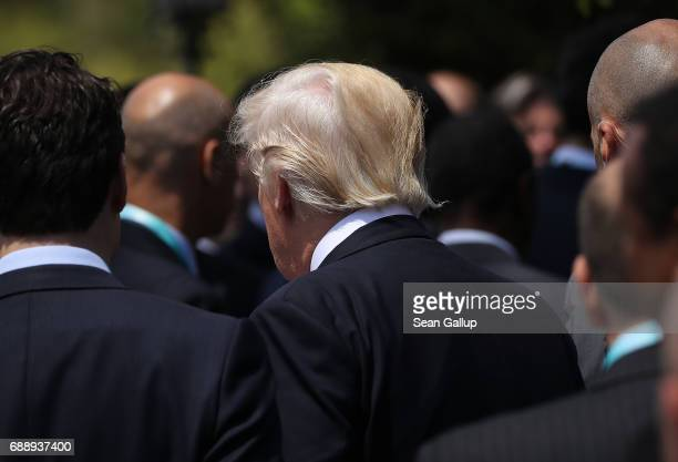 S President Donald Trump and other leaders depart after attending the group photo for the G7 Outreach Program on the second and last day of the G7...