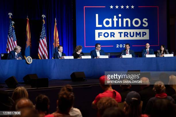 President Donald Trump and others participate in a roundtable rally with Latino supporters at the Arizona Grand Resort and Spa in Phoenix, Arizona on...