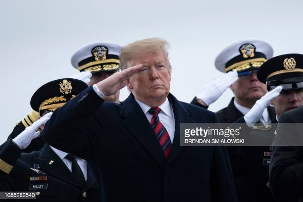 President Donald Trump and others pay their respects as the remains of Scott A. Wirtz, a Defense Intelligence Agency civilian and former Navy Seal,...