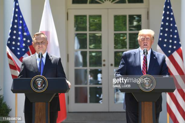 US President Donald Trump and Polish President Andrzej Duda hold a joint press conference in the Rose Garden of the White House in Washington DC June...