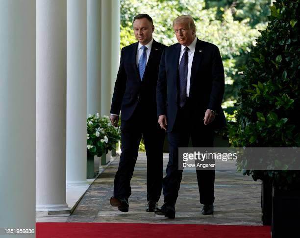 S President Donald Trump and Polish President Andrzej Duda walk to a joint news conference conference in the Rose Garden of the White House on June...