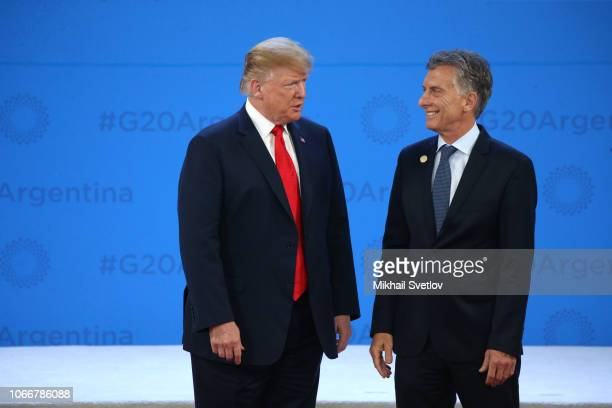 US President Donald Trump and President of Argentina Mauricio Macri greet each other during the welcoming ceremony prior to the G20 Summit's Plenary...