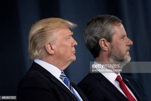 US President Donald Trump and President of Liberty University Jerry Falwell Jr listen to a song during Liberty University's commencement ceremony May...
