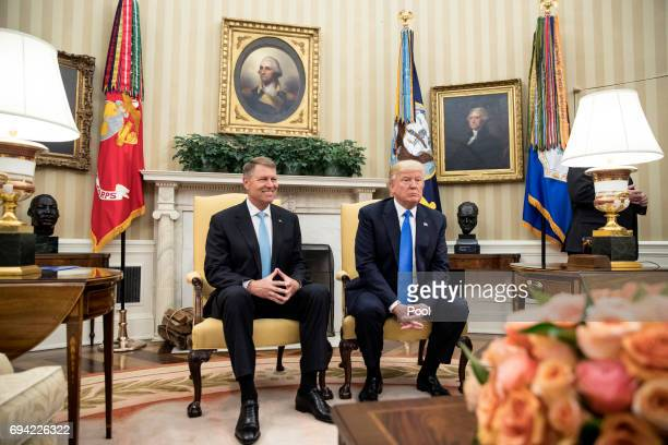 President Donald Trump and President of Romania Klaus Iohannis meet in the Oval Office of the White House on June 9 2017 in Washington DC
