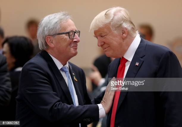 S President Donald Trump and President of the European Commission JeanClaude Juncker chat prior to the morning working session on the second day of...
