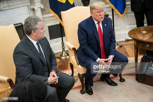 S President Donald Trump and President of the Republic of Colombia Ivan Duque Marquez address the press in the Oval Office of the White House on...
