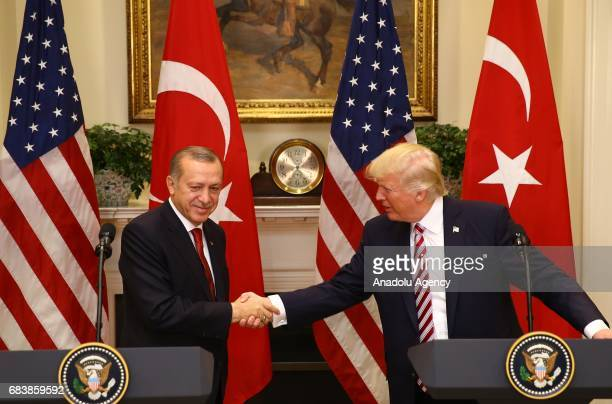 President Donald Trump and President of Turkey Recep Tayyip Erdogan shake hands during a joint press conference after their meeting at the Oval...
