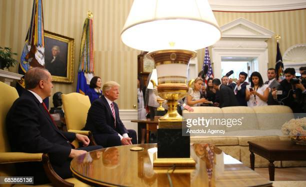 President Donald Trump and President of Turkey Recep Tayyip Erdogan pose for a photo during their meeting at the Oval Office of the White House in...
