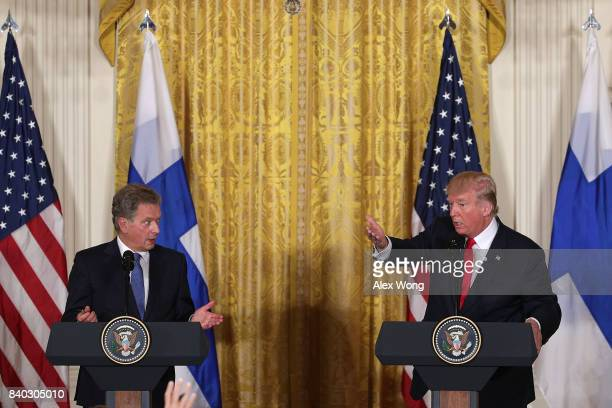 S President Donald Trump and President Sauli Niinisto of Finland participate in a joint news conference at the East Room of the White House August 28...