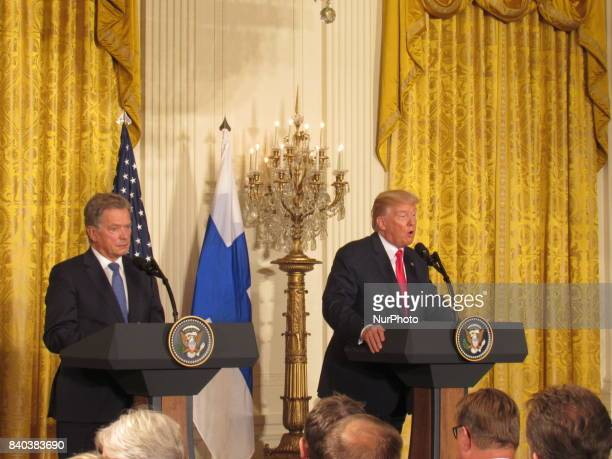 President Donald Trump and President Sauli Niinisto of Finland participate in a joint news conference at the East Room of the White House August 28...