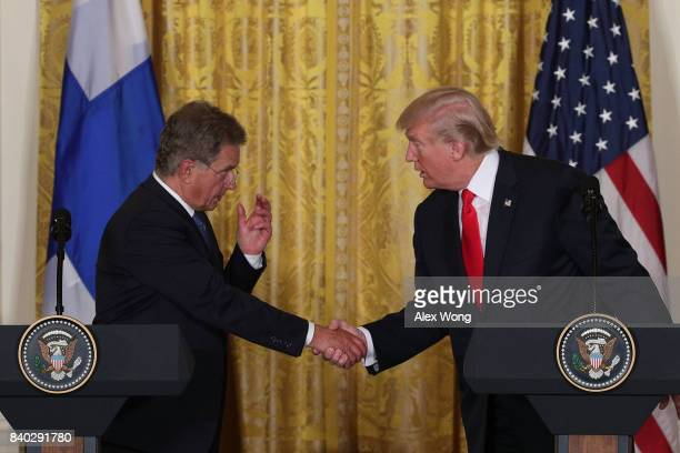 S President Donald Trump and President Sauli Niinisto of Finland shake hands during a joint news conference at the East Room of the White House...