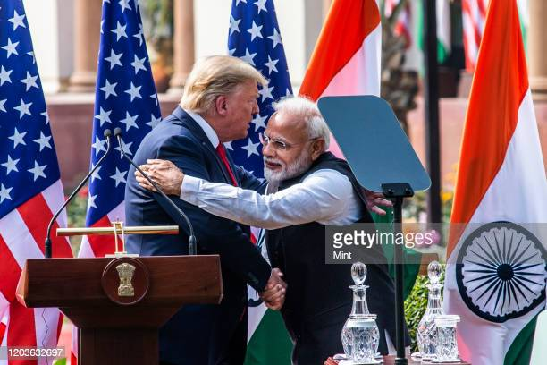 President Donald Trump and Prime Minister Narendra Modi greet each other after their joint statement, at Hyderabad House, on February 25, 2020 in New...