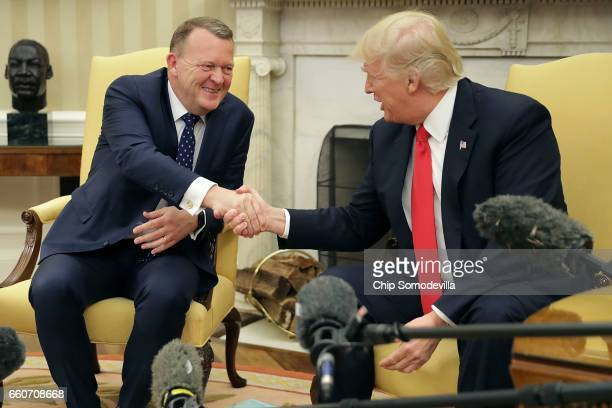 President Donald Trump and Prime Minister Of Denmark Lars Lokke Rasmussen shake hands for the press in the Oval Office at the White House March 30,...