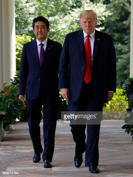 US President Donald Trump and Prime Minister of Japan Shinzo Abe walk out from the Oval Office before their joint news conference in the Rose Garden...