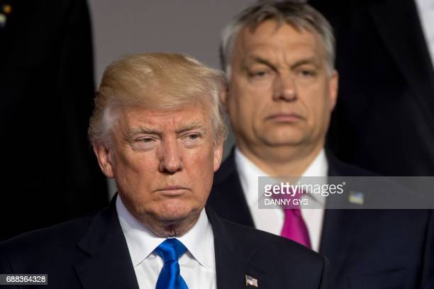 US President Donald Trump and Prime Minister of of Hungary Viktor Orban stand during a family picture during the NATO summit at the NATO headquarters...