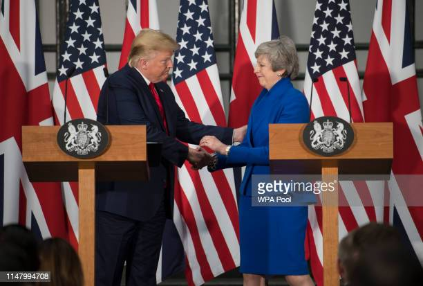 President Donald Trump and Prime Minister Theresa May shake hands during a joint press conference at the Foreign Commonwealth Office during the...
