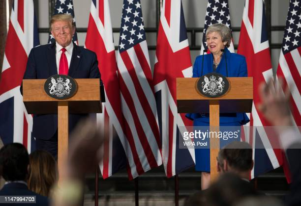President Donald Trump and Prime Minister Theresa May take questions from journalists during a joint press conference at the Foreign Commonwealth...
