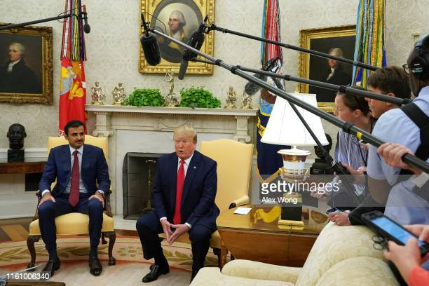 President Donald Trump and Qatari Emir Sheikh Tamim bin Hamad Al Thani during an Oval Office meeting at the White House July 9, 2019 in Washington,...