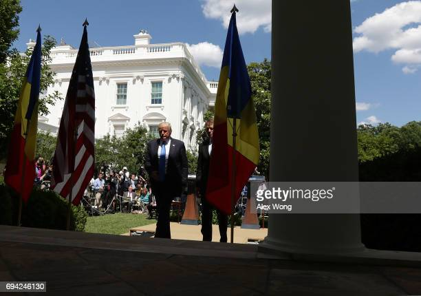 President Donald Trump and Romanian President Klaus Iohannis leave after a joint news conference in the Rose Garden at the White House June 9 2017 in...