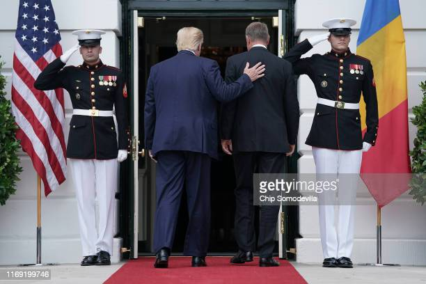 S President Donald Trump and Romanian President Klaus Iohannis walk into the White House August 20 2019 in Washington DC This is Iohannis' second...