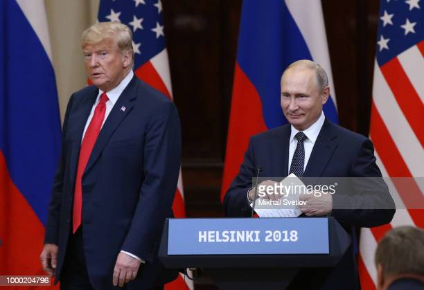 US President Donald Trump and Russian President Vladimir Putin arrive for a joint press conference after their summit on July 16 2018 in Helsinki...