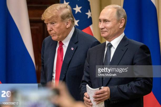 President Donald Trump and Russian President Vladimir Putin arrive to waiting media during a joint press conference after their summit on July 16,...