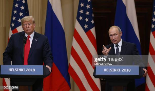 US President Donald Trump and Russian President Vladimir Putin attend a joint press conference after their summit on July 16 2018 in Helsinki Finland...