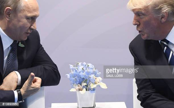 US President Donald Trump and Russian President Vladimir Putin hold a meeting on the sidelines of the G20 Summit in Hamburg Germany July 7 2017 / AFP...