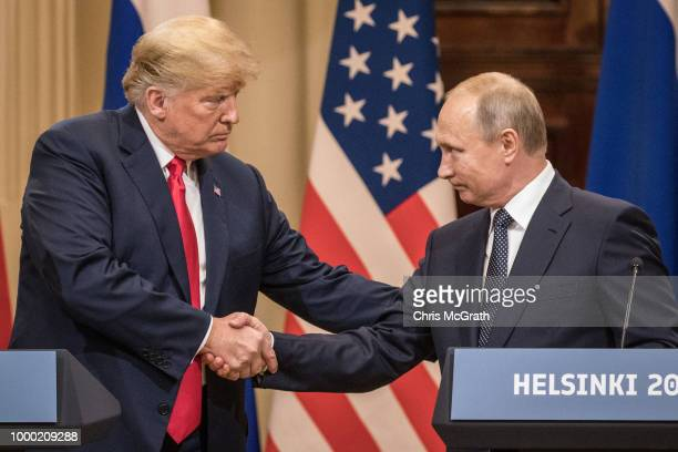 Russian President Vladimir Putin and US President Donald Trump shake hands before a meeting in Helsinki on July 16 2018