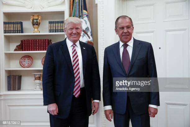 President Donald Trump and Russia's Foreign Minister Sergei Lavrov pose for a photo as they meet at the Oval Office of White House in Washington DC...