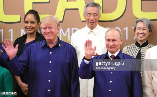 US President Donald Trump and Russia's President Vladimir Putin are seen during a family photo ceremony at the 2017 AsiaPacific Economic Cooperation...