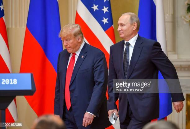 US President Donald Trump and Russia's President Vladimir Putin arrive to attend a joint press conference after a meeting at the Presidential Palace...