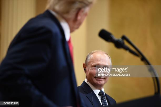 President Donald Trump and Russia's President Vladimir Putin attend a joint press conference after a meeting at the Presidential Palace in Helsinki...