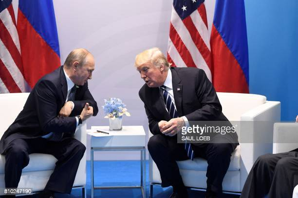 US President Donald Trump and Russia's President Vladimir Putin hold a meeting on the sidelines of the G20 Summit in Hamburg Germany on July 7 2017 /...