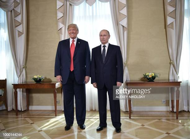 US President Donald Trump and Russia's President Vladimir Putin pose ahead a meeting in Helsinki on July 16 2018 The US and Russian leaders opened an...