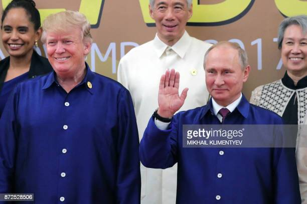 US President Donald Trump and Russia's President Vladimir Putin pose for a group photo ahead of the AsiaPacific Economic Cooperation Summit leaders...