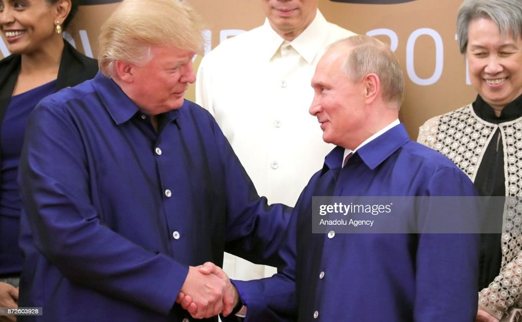 US President Donald Trump (L) and Russia's President Vladimir Putin (R) shake hands during a family photo ceremony at the 2017 Asia-Pacific Economic Cooperation (APEC) summit in Da Nang, Vietnam on November 10, 2017.