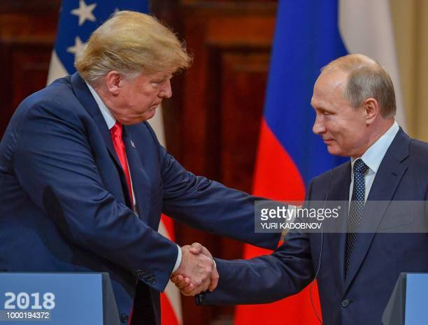 US President Donald Trump and Russia's President Vladimir Putin shake hands before attending a joint press conference after a meeting at the...