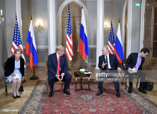 US President Donald Trump and Russia's President Vladimir Putin wait ahead a meeting in Helsinki on July 16 2018 The US and Russian leaders opened an...